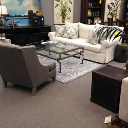 Showroom 2015 - Carson Sofa from Sam Moore, Cocktail Table from Caracole, Artwork from Leftbank & Bramble, Bookcase from Hooker Furniture, Area Rug from Surya, Accent Chair from Sam Moore, TV Console from Hammary