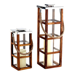 "Riado - Linea Teak Lantern 32"" - What do you get when you combine teak wood, stainless steel and a rope? A rustic lantern with a refined elegance. Crafted by hand, others can't hold a candle to this beauty."