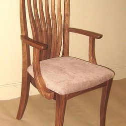 PACIFIC CLASSIC DINING CHAIR WITH FLEUR ARM - Our dining chairs come in a variety of styles and woods. We have a selection of arm styles to chose from, as well. Many of our chairs come with a carved wood seat option, graded upholstery options, or C.O.M. or C.O.L options as well. Since we build to order, we can adjust the seat height to meet your individual needs.