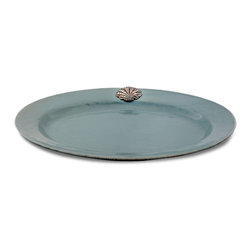 Coquille Oval Tray - Mist - A low profile makes the Coquille Oval Tray a practical piece for serving appetizers and aperitifs, as well as for displaying small objets d'art from your travels � and the pewter scallop that ornaments its rim conveys flawless grandeur to that otherwise unadorned shape.  Its subtle glaze also picks up the pewter hue, mingling it with evocative sea mist shades.
