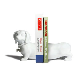 Danya B. - Dauchshound bookend set WHITE - Personality plus shows on our white Dachshund dog bookends.  This wiener  dog expands to hold you favorite books securely. Bottom is lined to protect furniture. Packed in an attractive color gift box, these bookends are the perfect gift for  all dog lovers.