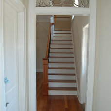 Traditional Staircase by Hood Herring Architecture Pllp