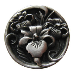 """Inviting Home - River-Iris Knob (antique pewter) - Hand-cast River-Iris Knob in antique pewter finish; 1-3/8"""" diameter Product Specification: Made in the USA. Fine-art foundry hand-pours and hand finished hardware knobs and pulls using Old World methods. Lifetime guaranteed against flaws in craftsmanship. Exceptional clarity of details and depth of relief. All knobs and pulls are hand cast from solid fine pewter or solid bronze. The term antique refers to special methods of treating metal so there is contrast between relief and recessed areas. Knobs and Pulls are lacquered to protect the finish. Alternate finished are available.. Detailed Description: The River Iris pulls has a very incredible dynamic. It looks as if the two flowers are actually in the process of growing sideways - they look in motion. The River Iris pulls looks vibrant with the circle detail in the middle - which makes the River Iris knobs incredibly easy to work in."""