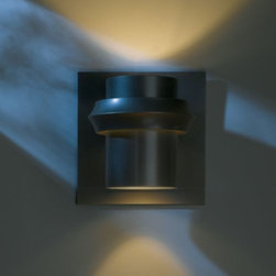 Hubbardton Forge - Twilight Outdoor Wall Sconce by Hubbardton Forge - The Hubbardton Forge Twilight Outdoor Wall Sconce illuminates the night with light diffused through the top and bottom of the durable, rust-free aluminum cylinder, as well as around the ring that holds it to the wall plate. Includes an optional top plate to control the wash of uplight as desired. Available in a variety of finishes and lamping options. Hubbardton Forge, headquartered in Hubbardton, Vermont, hand-forges simple and elegant metal lighting fixtures and accessories, combining ancient hand-forging techniques with environmentally-sound finishing practices.