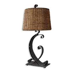 Uttermost - Rendall Metal Table Lamp - Metal meets rattan: an unlikely combo that works remarkably well to light your favorite setting. The curvy, hammered black base and natural woven shade make a unique style statement.