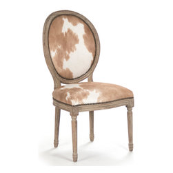 "Kathy Kuo Home - Pair Madeleine French Country Oval Brown Hair on Hide Dining Chair - A naturally gorgeous, hide upholstered chair wins ""Best in Show"" as a unique accent chair or in a group around a dining table. The oak frame is finished in a dark limed grey, covered in cream and brown cowhide, then finished in antique brass nail head trim. Unique variations in hide make each piece a one-of-a-kind creation."