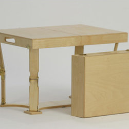 Spiderlegs - Portable Folding Coffee Table - Spiderlegs handcrafted portable wooden folding coffee table with a patented folding design and original locking hardware, is made in the USA and crafted from Baltic Birch ply. Quality craftsmanship and special care is taken to match wood between the folding halves of the table. Table folds like a briefcase for easy storage and has its own built in handle for easy for transport. The unique folding table base adds stability. Items such as coasters or games can be stored or carried in spaces inside the folded table. The compact folded size makes for easy storage. Features: -Unique patented folding design.-Hinge lock can be released by pressing the solid brass lock buttons.-Folds to a small case with built in carry handle for easy transport.-Unique base adds stability.-May be used indoors or outdoors.-Clean with a damp cloth.-Collection: Portable Folding.-Distressed: No.-Gloss Finish: No.-Top Material: Wood.-Base Material: Wood.-Base Type: Flat Folding.-Solid Wood Construction: No.-Reclaimed Wood: No.-Number of Items Included: 1.-Hardware Material: Plated Steel.-UV Resistant: No.-Weather Resistant: No.-Scratch Resistant: No.-Stain Resistant: Yes.-Moisture Resistant: Yes.-Design: Folding.-Drop Leaf: Yes.-Shape: Rectangle.-Lift Top: No.-Tray Top: No.-Storage Under Tabletop: No.-Folding: Yes.-Hand Painted: Stained by hand.-Magazine Rack: No.-Built In Clock: No.-Powered: No.-Legs Included: Yes -Leg Type: Folding..-Casters: No.-Exterior Shelves: No.-Hardware Finish: Yellow Zinc or Brass.-Adjustable Height: No.-Glass Component: No.-Upholstered: No.-Weight Capacity: 100 lbs.-Swatch Available: No.-Commercial Use: No.-Recycled Content: No.-Eco-Friendly: Yes.-Country of Manufacture: United States.Specifications: -FSC Certified: No.-ISTA 3A Certified: No.-ISTA 1A Certified: No.-CARB Certified: Yes.-General Conformity Certified: No.-Green Guard Certified: No.-ISO 9000 Certified: No.-ISO 14000 Certified: No.Dimensions: -Overall Height - T