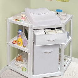 Badger Basket - Badger Basket Diaper Corner Baby Changing Table with Hamper and Basket - White - - Shop for Changing Tables from Hayneedle.com! The Badger Basket Diaper Corner Baby Changing Table with Hamper and Basket White is a unique changing table that correctly places caregivers at the business end of the baby for a smoother change every time. This streamlined unit fits neatly in the corner to provide storage space and a hamper that simply slides out and can be swapped for your diaper pail. If you aren't using the hamper your diaper pail will fit conveniently into that spot too! Above the hamper you'll find a basket with a handle that acts as a drawer for keeping blankets and supplies within reach. The basket also pulls out completely to accommodate you if you prefer open storage. This changing table meets all current safety and testing requirements. All paints and finishes are non-toxic. It's made of solid and engineered wood with veneers. This changing table includes a contoured changing pad with a safety belt and one removable cover of white terry cloth. This corner unit is keen to switch careers and become a storage/book shelf or TV/Media center after its changing table days.Illustrated assembly instructions are included. Assembly requires a screwdriver. This unit is designed for children weighing up to 30 pounds. The hamper and basket are crafted of cotton/poly blend fabric and the hamper can fold flat for storage. The basket offers excellent breathability as it sits on rails not on a solid shelf.Additional Dimensions:Basket: 16W x 17.75D x 6H in.Hamper: 13.5W x 13.5D x 21.5H in.Changing pad: 16W x 31L x 3D in.Badger Basket CompanyFor over 65 years Badger Basket Company has been a premier manufacturer of baskets bassinets bassinet bedding changing tables doll furniture hampers toy boxes and more for infants babies and children. Badger Basket Company creates beautiful and comfortable products that are continually updated and refreshed bringing you exciting 
