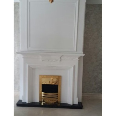 White Fireplace mantel with golden stove -