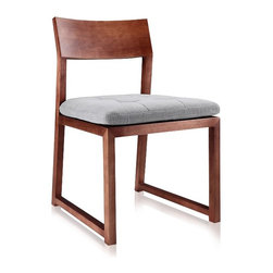 Modani - Bade Walnut Chair - The contemporary Baden Dining Chair features a classic and contemporary design. Composed of traditional wood in a walnut finish, this modern chair can be used as a dining room chair, or even a cozy office chair! The clean and sleek lines offer minimalist appeal and the soft grey cushion provides ultra-lux d̩cor and fine comfort. Available in both a modern walnut or black oak finish!