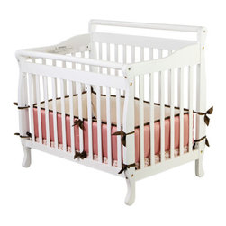 Dream On Me - Portable Convertible Crib - The Dream On Me Portable, convertible crib is a modern, yet classic style crib that is designed to transform with your child as they grow. This is one of the few portable, convertible cribs easily convert to a day bed and twin size bed growing with your child. It is the ideal solution for those small areas that are unable to accommodate a full size crib. Features: -3-in-1 Portable Convertible Crib.-Material: Solid pine wood.-Stationary side rail.-Dual hooded, safety, locking wheels.-This is a NON-Drop Side crib.-Non Toxic finish.-Portable Crib collection.-Distressed: No.Dimensions: -Mattress: 1'' H x 24'' W x 38'' L.-37.5'' H x 28'' W x 39.5'' D, 29.5 lbs.-Overall Product Weight: 29.5 lbs.