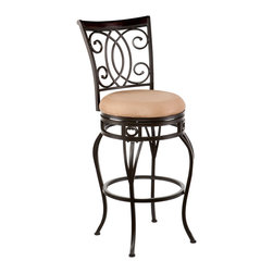 SEI - Maguire Swivel Bar Stool - Complement your decor with elegant, convenient seating. The intersected scrollwork and curved legs of this bar stool create a refined, stylish look. A powder-coated, dark champagne finish and durable steel frame deliver lasting quality. It features bar height seating, a cozy foam seat covered in plush acorn microfiber, and a scrolled backrest with a rich walnut finish wood accent. A full 360 degree swivel and footrest ring provide comfort and ease. The curvaceous form and attractive finish coordinate with traditional to contemporary decor styles. Ideal for the kitchen, breakfast nook, bar, or dining area.