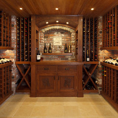 traditional wine cellar by Chr DAUER Architects