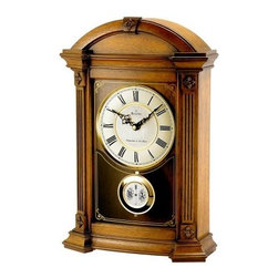 Bulova Allerton Mantel Clock - Bring Old World charm and beauty to your mantel top with the Bulova Allerton Mantel Clock. This gorgeous timepiece features a solid wood case with an Old World walnut finish. Angled corners with fluted pilasters and decorative carved accents add visual and architectural interest to this clock and a decoratively screened curved glass lens and two-tone metal dial add beauty and authenticity.The Allerton features triple-chime movement that plays your choice of Westminster Ave Maria or Bim Bam melodies on the quarter hour and the clock counts the hour. Volume control and night shut-off allow you to adjust the chime to suit your lifestyle. This wonderful clock is sure to become a treasured family heirloom. Dimensions: 11.75W x 4.5D x 17.5H inches.About Bulova CorporationThe realization of a great American dream began in 1875 when Joseph Bulova a 23-year-old immigrant from Bohemia opened a small jewelry store on Malden Lane in New York City. This modest enterprise was to evolve into one of today's preeminent watch and clock companies. In 1911 Bulova began manufacturing boudoir and desk clocks along with fine pocket watches which he made and sold in unprecedented numbers. During World War I wristwatches were issued in the military for their greater convenience. Returning veterans brought home the new fashion - and a new market emerged.Bulova timepieces use only the finest materials precision craftsmanship and state-of-the-art technology for enduring quality and performance. At the heart of each Bulova watch is precision accuracy. From the finest quartz movements to alternative technologies such as solar or mechanical energy each Bulova watch is guaranteed to be accurate to within one minute a year. Every Bulova is anti-magnetic shock-resistant and features the company's unique distortion-free and scratch-resistant Dura-Crystal.Only Bulova offers the range of styling and the scope of products to meet everyone's needs. From the sporty Marine St