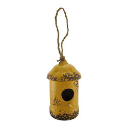 n/a - Yellow Porcelain Rounded Top Hanging Birdhouse 7.5 Inch. - Add an adorable accent to your yard that your feathered friends will appreciate. This porcelain birdhouse measures 7 1/2 inches tall, 4 inches in diameter, and has a 1 1/2 inch diameter opening with an inch long perch. Butterflies adorn each side of the opening, and a carefully crafted glazing gives the piece a wonderfully distressed look. A six inch loop of rope allows you to hang this birdhouse from a sturdy branch or pole hanger. It makes a thoughtful housewarming gift for a friend that is sure to be enjoyed year after year.