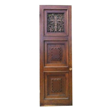 """Pre-owned Vintage Confessional Catholic Church Door - From your lips to Gods' ears..a stunning piece! This old confessional door salvaged from a church would make a perfect wine cellar door, coffee table or used as a decorate piece in the home. Features a solid oak with lovely detail trim on the front with a cross and grapes design done in bronze. In excellent condition.    Measurements: 83.25"""" tall x 27"""" wide x 1.75"""" thick."""