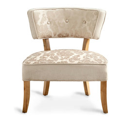 Miss Sweets Chair - Dimensional, velvety textures give a tactile coziness to the elegant frame of the Miss Sweets Chair, a neutral-hued seating piece with understated feminine details that make it as suited for service in a mid-century reading nook as it is for a traditional bedroom's vanity table.  The upward flare of the silhouette brings statement geometry to the simple but well-padded form.