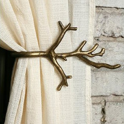 Branch Curtain Tieback - These bronzed branch curtain tiebacks are a gentle nod to the winter season, and they bring in just the right amount of whimsical flair. I'm a huge fan of decorating with branches, and I love that these are just one more way to incorporate the look.