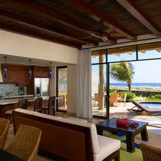 Tropical Living Room by Smith Firestone Associates