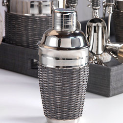 Woven Cane Cocktail Shaker - With a stunning grey woven sugarcane detailing the outer portion of the shaker along with it's shining nickel composition, the Woven Cane Cocktail Shaker and corresponding collection epitomizes casual elegance. Utilize the matching Bartool Set, Ice Bucket and Wine Chiller in your pool house or pub room and you have a beautiful collection for your bar that is sure to delight.