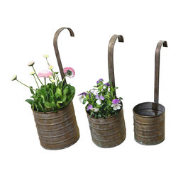 Pier Surplus - Hanging Metal Flower Planters - Set of Three with Hanging Handles #PL221876 - Varying in size, these hanging metal planters are a graceful way to display blooming plants on your porch, deck, or fence. Each is made from high-quality metal with no sharp edges. The handle has been securely welded for long life. This set offers a fun, attractive way to display your favorite plants. Why not use them to grow kitchen herbs which can be hung within reach of your cutting board?