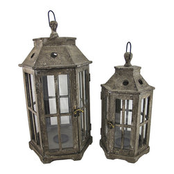 Pair of Large Wood and Glass Outdoor Pillar Candle Lanterns 26 Inch, 19 Inch - This pair of decorative lantern is a beautiful accent to your home, patio or porch. Made of wood, with glass sides, the larger lantern measures 26 inches tall, has a 12 inch by 12 inch base. The smaller one measures 19 inches tall and has a 8 1/2 inch by 8 1/2 inch base. Both of them have a metal candle holder in the center that holds up to a 3 inch diameter pillar candle. The lanterns also have metal hangers at the top, so they could be hung with a decorative chain or from a wall bracket, but hanging hardware is not included. A fun alternative to traditional candles is battery powered LED candles with timers, for worry-free accent lighting. The lantern also looks great with a string of battery powered LED lights placed in it. This lantern is a great addition to your home, and makes a lovely gift.