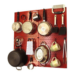 Kitchen Pegboard Organizer Kit - I have wanted to store my pots and pans like this forever. Instead of fighting a messy stack in the cupboard, just lift one easily off the wall.
