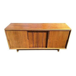 Pre-owned Mid-Century Modern 12-Drawer Credenza - Expansive Mid-Century modern twelve-drawer credenza by Cavalier. Three sliding panels, brass highlights and plenty of storage. Ideal for use as a dresser or media cabinet.