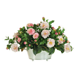 Winward Home - Garden Camellia Centerpiece - The camellia flower is nestled in a bed of magnolia foliage. A brushed silver footed pot provided our designers generous space to accommodate a terrific amount of this charming flower