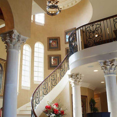mediterranean staircase by Lowrey Design Group, Inc