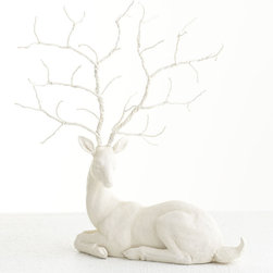 FESTIVE ORNAMENTAL DEER - NEW - Almost as if nestled under a snow covered pine, this deer rests majestically with its branching antlers. It's made from magnesia, finished by hand in white, with antlers of malleable wire. Bend and twist them to hang ornaments and garland on for his own special Christmas display. He's the ideal size for a tabletop or mantle.