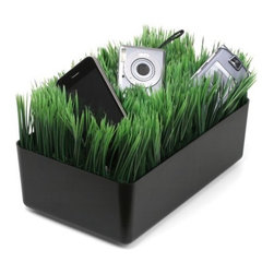 Kikkerland Grass Charging Station, Black - Hide your messy electronic accessory cords amongst the lush faux grass of this charging station.