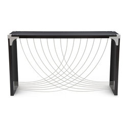 Peter Harrison - Divergence Table - Divergence's exposed aluminum corner bracket perfectly combines function and elegance. The table features two bold swaths of stainless steel cable which cross in a dynamic fan. The cable is movable to the touch, yet falls back into position every time.