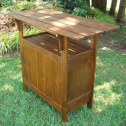 International Caravan - Outdoor Bar in Acacia Wood w Natural Stain - Entertain, serve, display - you can do it all with this outdoor bar table. The sturdy piece has Acacia hardwood framework, cantilevered slat tabletop, rich stain finish and convenient underneath storage space. Built for year round enjoyment, it's sure to be a favorite. In stain finish. Made of Acacia hardwood. Heavy duty. 22 in. W x 48 in. L x 40 in. H