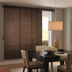 Bali Vertical Blind Alternatives - Woven Wood Sliding Panels. Whites and off-whi - Woven Wood Sliding Panels - Buy with Confidence, Get Free Samples Today!Choose Bali Woven Wood Sliding Panels from Blinds.com to bring a sleek and modern look to your patio doors or larger windows.  Also known as Panel Track, this product can also be used as a room divider or to cover a closet.  With over dozens of natural material choices, you're sure find the perfect complement to your decor.   These panels will slide effortlessly across a durable aluminum track.  Personalize your look by choosing from a variety of panel sizes.  Select a one-way or split draw, and finish your look by adding one of our valances.The materials in this collection match Bali Woven Wood Shades.
