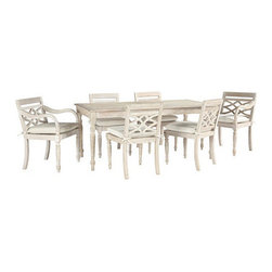 Ballard Designs - Ceylon Whitewash 7-Piece Rectangular Dining Set - This set is so beautiful, you'll be tempted to use it inside, but it's really designed for outdoor living. It would be wonderful on a lanai, porch or even out on the lawn. Invite some friends over; it's time to celebrate with good food and cold drinks out under the stars.