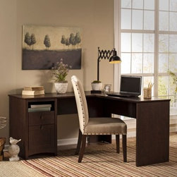 Bush Buena Vista 60 in. L-Shaped Desk - Madison Cherry - Whether it's placed in a corner or in the middle of a room, the Bush Furniture Buena Vista 60 in. L-Shaped Desk - Madison Cherry will look right at home. With plenty of workspace you'll be able to spread your work out and still have room for a computer, printer, and other office equipment.This contemporary desk has a pedestal with open storage for easy-to-access to papers and books, a box drawer perfect for supplies, and a file drawer that accommodates letter-sized documents and files.Full of functionality and able to leave a small footprint, this L-shaped desk also has ample appeal in its elegant post leg design and curved base-rails accented by aged, bronze-metal drawer hardware. Its durable design and wood solids and veneers construction also resists nicks and scratches, making it a practical and attractive choice for your home office.About Bush FurnitureBush Furniture is the eighth largest furniture company in the United States. Bush manufactures high-quality products, which are designed to be easily assembled and provide great value for the price. Bush furniture is made from a combination of particleboard, fiberboard, and solid wood components. The use of real wood components will be noted in the product description, if applicable.Bush Industries has over 4,000,000 total square feet of manufacturing, warehousing, and distribution space. This allows for a very wide selection of high-quality furniture with the ability to ship quickly. All standard residential Bush products carry a generous 6-year warranty. All Bush business furniture, including the A series, C series, and Quantum series, is backed by a 10-year warranty from Bush, one of the best in the industry.