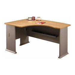 Bush Business - Left L-Bow Desk in Light Oak - Series A - With its classic finish, the Left L Bow Desk in Light Oak makes a cheerful, practical, and professional choice.  It provides wire access and can be completed with an articulating keyboard shelf as well as a pencil drawer.  This L-shaped computer desk with handsome, light oak finish desktop is expertly crafted to accommodate the needs of professionals and students.  Its 1 inch thick desktop ensures resilience and durability while its dependable design enables you to comfortably set everything from text books and to weekly reports.  This desk is perfect for you office with it's simple design and construction. * With its classic finish, the Left L Bow Desk in Light Oak makes a cheerful, practical, and professional choice. It provides wire access and can be completed with an articulating keyboard shelf as well as a pencil drawer. 59.291 in. W x 43.307 in. D x 29.764 in. H