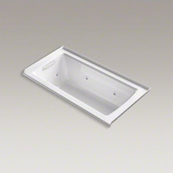 "KOHLER - KOHLER Archer(R) 60"" x 30"" three-side integral flange whirlpool with heater and - Taking its design cues from traditional Craftsman furniture, the Archer line of baths reveals beveled edges and curved bases for a clean, sophisticated style. This bath offers a low step-over height while allowing deep, comfortable soaking. Whirlpool jets relax away the day's tension as a built-in heater keeps your water at the perfect temperature. KOHLER ExoCrylic(TM) is the next generation of bathroom acrylics, featuring a lighter weight for easier installation and 90% fewer VOCs produced during manufacturing."