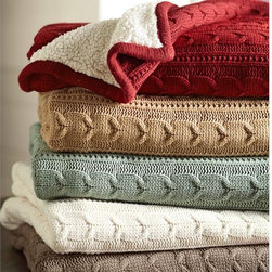 Cozy Cable-Knit Throw - There are many a cable-knit throw on the internet, but they are not all created equal.  I searched for the perfect one and found it here at Pottery Barn, in fact.  This one is lined with faux sheepskin for an extra cozy feel.  Now that's worth cuddling up to!