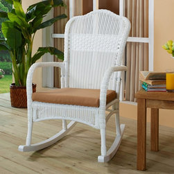 Coral Coast - Coral Coast White Resin Wicker Rocking Chair with Khaki Cushion - CW4279R WHITE/ - Shop for Chairs and Sofas from Hayneedle.com! Whether you're rocking on your porch during the warm summer months or enjoying the smooth gentle motion while watching your favorite movie the Coral Coast White Resin Wicker Rocking Chair with Khaki Cushion is both beautiful and comfortable. This rocking chair is crafted from beautiful resin wicker which has all the classic elegance of traditional wicker along with added durability and strength. Resin wicker is made to withstand UV rays and is water resistant it also doesn't fade over time making it a great choice for indoor or outdoor use. You'll fall in love with its classic look and feel as well as its white finish and luxurious khaki cushion. Gentle sloping arms and a mixed weave back add an elegant touch to this rocking chair. Easy to clean with mild soap and water this rocking chair is a gorgeous addition to any home. Additional Features All-weather resin wicker is made to last UV- and water-resistant Does not fade over time Easy to clean and maintain About Coral CoastWhat if when you closed your eyes you pictured yourself in your own backyard? Coral Coast has a collection of easygoing affordable outdoor accessories for your patio pool or backyard. The latest colors and styles mingle with true classics in weather-worthy fabrics and finished woods ready for relaxation. Make yours a life of leisure.