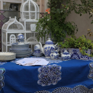 Deep blue lace tablecloth - This vintage piece is one of our tablecloths with a dramatic amount of detailed lace in the center and along the edge of the cloth. The deep blue would look fine in a large room or beachside patio. A great example of Paraguayan nanduti (lace).