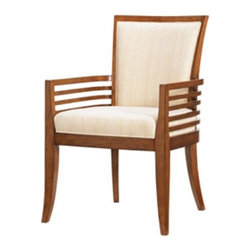 Tommy Bahama - Tommy Bahama by Lexington Home Brands Ocean Club Kowloon Arm Chair Multicolor - - Shop for Dining Chairs from Hayneedle.com! If you are someone who appreciates casual laid-back elegance the Tommy Bahama Home Ocean Club Kowloon Arm Chair is sure to impress you with its disarming island charm. Designed to make an impression in most upscale dining spaces this chair's upholstered seat and back in woven taupe and cream fabric envelop you in such luxurious comfort that you might be tempted to linger at the table longer than necessary! Clean lines elegantly tapered legs and a smart silhouette add to this chair's upscale appeal. Sturdily constructed of select hardwoods and hickory veneers and finished in warm Bali Brown this handsome arm chair is just what you need to transform your dining space into a tropical resort.About Tommy Bahama HomeTommy Bahama started as an upscale men's casual sportswear line and has transformed into a signature brand expanding their product line to accommodate women's apparel golf wear footwear home furnishings and even retail and restaurant compounds. The Tommy Bahama brand represents quality products with fashion forward designs that are available at an affordable price. Their signature island-lifestyle designs suggest a modern style with an emphasis on comfort and relaxation.