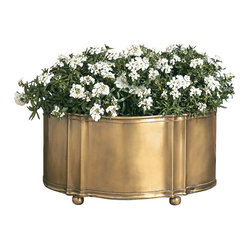 Antique Brass Planter - Silky finish in warm antique brass makes a fine contrast with the contents of the Antique Brass Planter, its warm burnished color and well-presented smoothness juxtaposed with the delicate details of flowering houseplants or of transitional fillers for the oval metal cachepot. A form inspired by decor ative keepsake boxes includes ball feet, trimmed edges, and detailed angles.