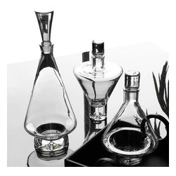 Set of 3 Clear Glass Tapered Decanters - Welcome home. You've just closed the biggest deal of your career, and you deserve a reward. You look to your dining room bar and these Clear Glass Tapered Decanters look back at you, inviting you to treat yourself to a slow, sweet sip of whiskey, bourbon, or brandy. The modern-inspired design is as classy as you feel, and you can wet your whistle knowing we've crafted these beauties from natural materials that don't strain the environment. The only thing left for you to do is choose what treat you'll give yourself this evening.