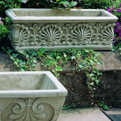 Campania International Rectangle Shell Cast Stone Planter - About Campania InternationalEstablished in 1984, Campania International's reputation has been built on quality original products and service. Originally selling terra cotta planters, Campania soon began to research and develop the design and manufacture of cast stone garden planters and ornaments. Campania is also an importer and wholesaler of garden products, including polyethylene, terra cotta, glazed pottery, cast iron, and fiberglass planters as well as classic garden structures, fountains, and cast resin statuary.Campania Cast Stone: The ProcessThe creation of Campania's cast stone pieces begins and ends by hand. From the creation of an original design, making of a mold, pouring the cast stone, application of the patina to the final packing of an order, the process is both technical and artistic. As many as 30 pairs of hands are involved in the creation of each Campania piece in a labor intensive 15 step process.The process begins either with the creation of an original copyrighted design by Campania's artisans or an antique original. Antique originals will often require some restoration work, which is also done in-house by expert craftsmen. Campania's mold making department will then begin a multi-step process to create a production mold which will properly replicate the detail and texture of the original piece. Depending on its size and complexity, a mold can take as long as three months to complete. Campania creates in excess of 700 molds per year.After a mold is completed, it is moved to the production area where a team individually hand pours the liquid cast stone mixture into the mold and employs special techniques to remove air bubbles. Campania carefully monitors the PSI of every piece. PSI (pounds per square inch) measures the strength of every piece to ensure durability. The PSI of Campania pieces is currently engineered at approximately 7500 for optimum strength. Each piece is air-dried and then de-molded by hand. After an internal quality check, pieces are sent to a finishing department where seams are ground and any air holes caused by the pouring process are filled and smoothed. Pieces are then placed on a pallet for stocking in the warehouse.All Campania pieces are produced and stocked in natural cast stone. When a customer's order is placed, pieces are pulled and unless a piece is requested in natural cast stone, it is finished in a unique patinas. All patinas are applied by hand in a multi-step process; some patinas require three separate color applications. A finisher's skill in applying the patina and wiping away any excess to highlight detail requires not only technical skill, but also true artistic sensibility. Every Campania piece becomes a unique and original work of garden art as a result.After the patina is dry, the piece is then quality inspected. All pieces of a customer's order are batched and checked for completeness. A two-person packing team will then pack the order by hand into gaylord boxes on pallets. The packing material used is excelsior, a natural wood product that has no chemical additives and may be recycled as display material, repacking customer orders, mulch,or even bedding for animals. This exhaustive process ensures that Campania will remain a popular and beloved choice when it comes to garden decor.Please note this product does not ship to Pennsylvania.
