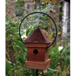 Heartwood - Lantern Loft Bird House -Mahogany - This  beautiful  birdhouse  is  the  perfect  addition  to  any  home  or  garden  of  your  choice.  Hand-burnished  copper  roof  and  powder  coated  loop  bail  adds  geometric  flair  to  solid  mahogany  durability  and  beauty.  Your  birdhouse  is  sure  to  please  all  family,  friends  and  guests.This  bird  house  is  one  you  will  enjoy  in  the  years  to  come.                  8x8x16              1-3/8  hole              Handcrafted  in  USA  from  renewable,  FSC  certified  wood