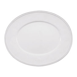 Clos du Manoir Dinner Plate - Enjoy handsomely-presented meals with ease on Clos du Manoir Dinner Plates. of standard size for this most basic piece of dishware and colored a solid, easy-to-mix pure white, the dinner plate allows you to mix in favorite accent dishes as well as your placemats or chargers, but its shape is an unconventional oval to add a mild quirk of personality to the laying of your table.