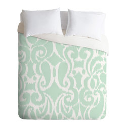 Khristian A Howell Eloise Queen Duvet Cover - You know you can't resist this perfect pop of color and pattern. The curvy, fresh aqua and white ikat pattern on top reverses to pure white dreaminess underneath for go-with-anything style. Slip it over your favorite duvet, zip the hidden zipper and rest easy.