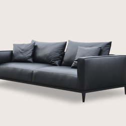 California Modern Sofa by Sohoconcept - California Sofa is a stylish two-seat sofa with cushions that offer extra comfort. The California sofa contains high density of foam in the seat and back cushion. To maintain a great level of comfortableness, pocket springs are placed in the seat cushion. The sofa is built on solid birch wood frame. The base is finished with black powder coating steel. The loose removable cushions are zippered and filled with down and feather. California Sofa is available in Black Pepper and Grey Brick cotton fabric as well as Brown Genuine Leather. The sofa is suitable for both residential and commercial use.